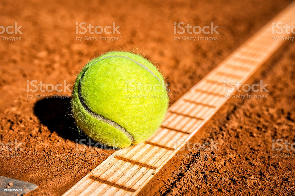 Tennis ball on the clay court stock photo