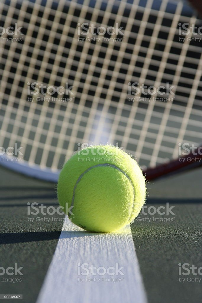 Tennis Ball on the Court line with a racket royalty-free stock photo
