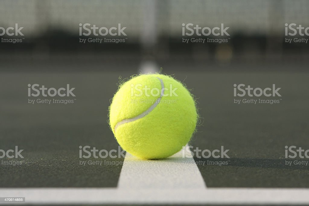 Tennis Ball on the Court Lines royalty-free stock photo