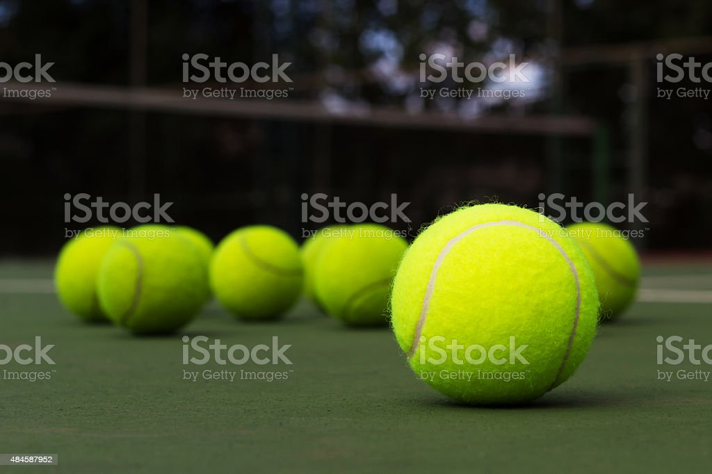 Tennis Ball  on the court stock photo