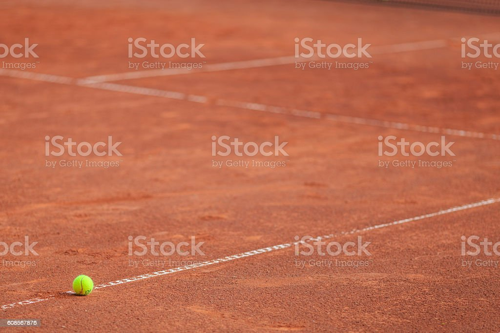 Tennis ball on the ground stock photo