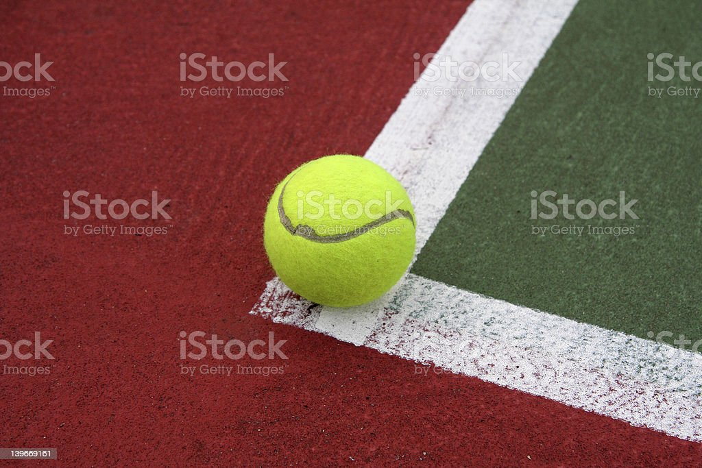 Tennis Ball on the Line royalty-free stock photo