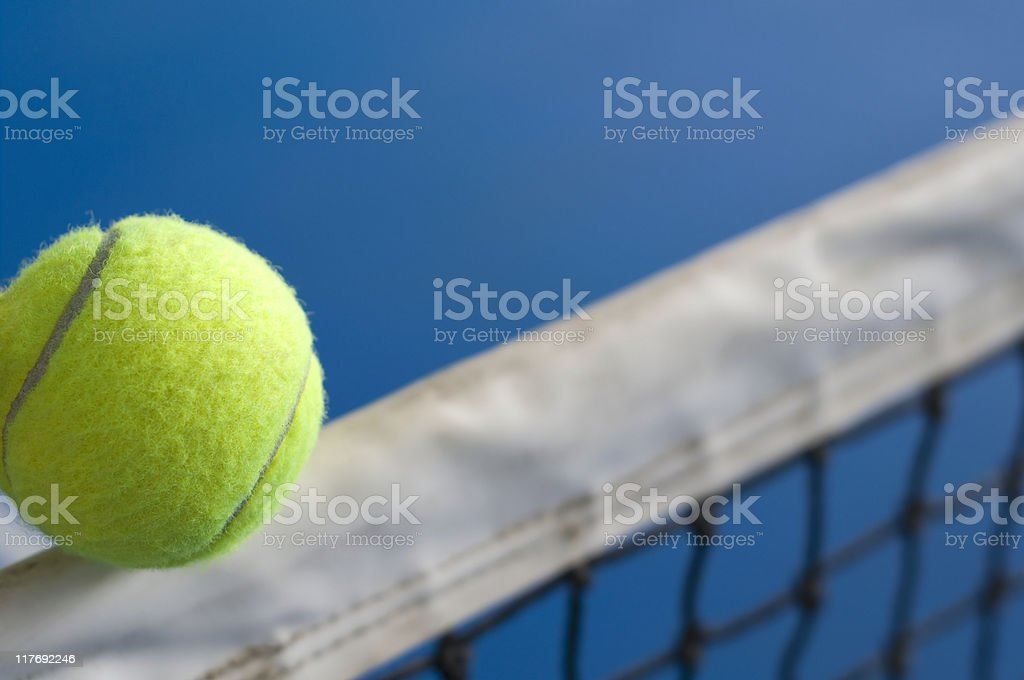 Tennis ball on the net in action royalty-free stock photo