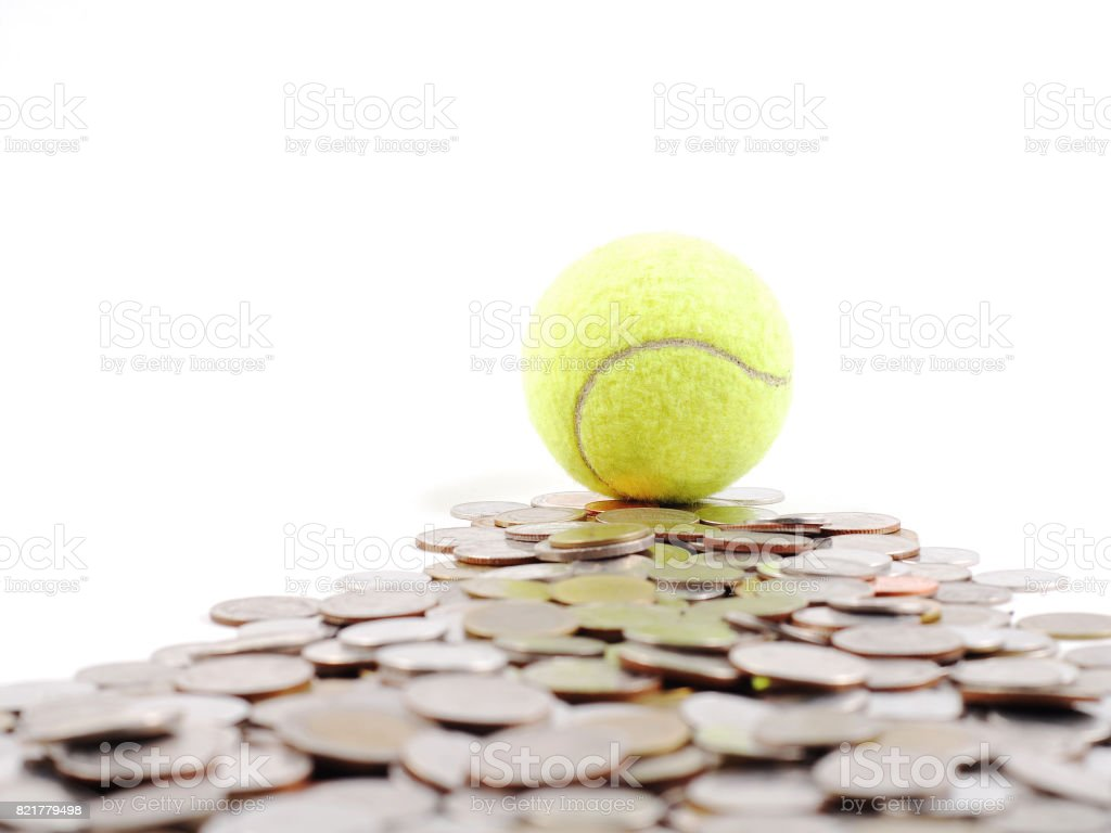 tennis ball on the way of money prize stock photo