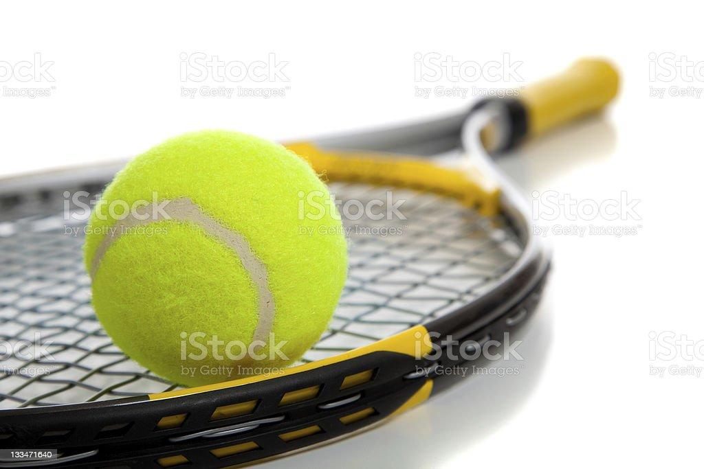 Tennis ball on top of a tennis racket stock photo
