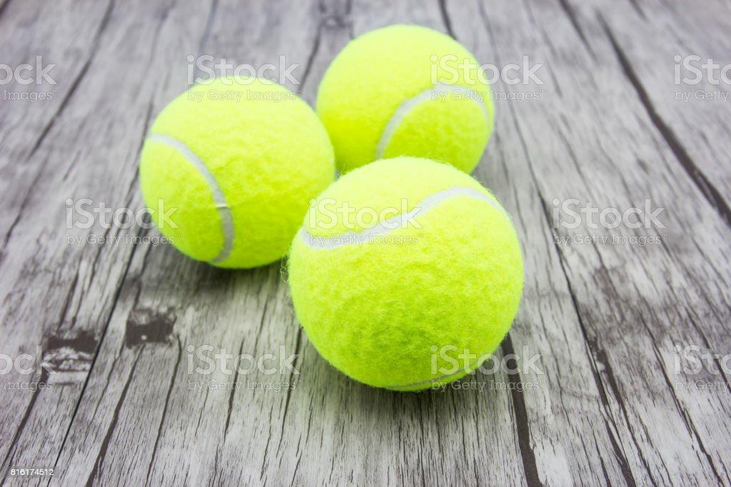Tennis ball on wood floor stock photo