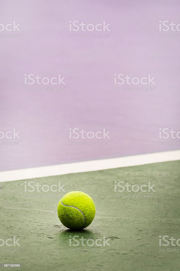 Tennis ball out of court stock photo