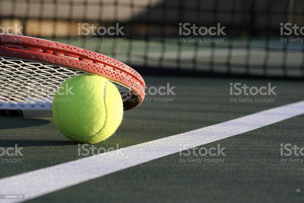 Tennis Ball & Racket on a Green Outdoor Court stock photo