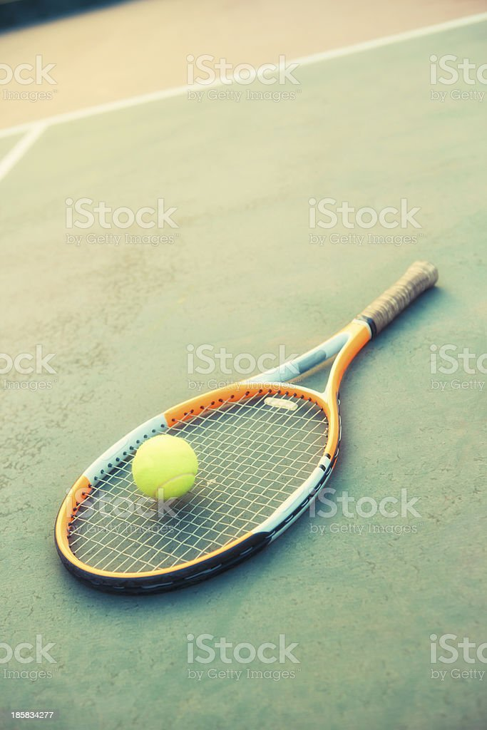 Tennis Ball & Racket on a Green Outdoor Court royalty-free stock photo