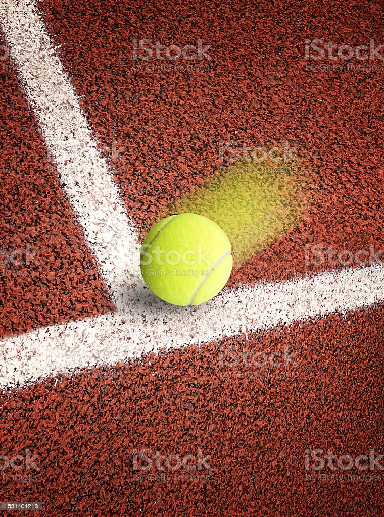 Tennis ball to corner red ground field line stock photo