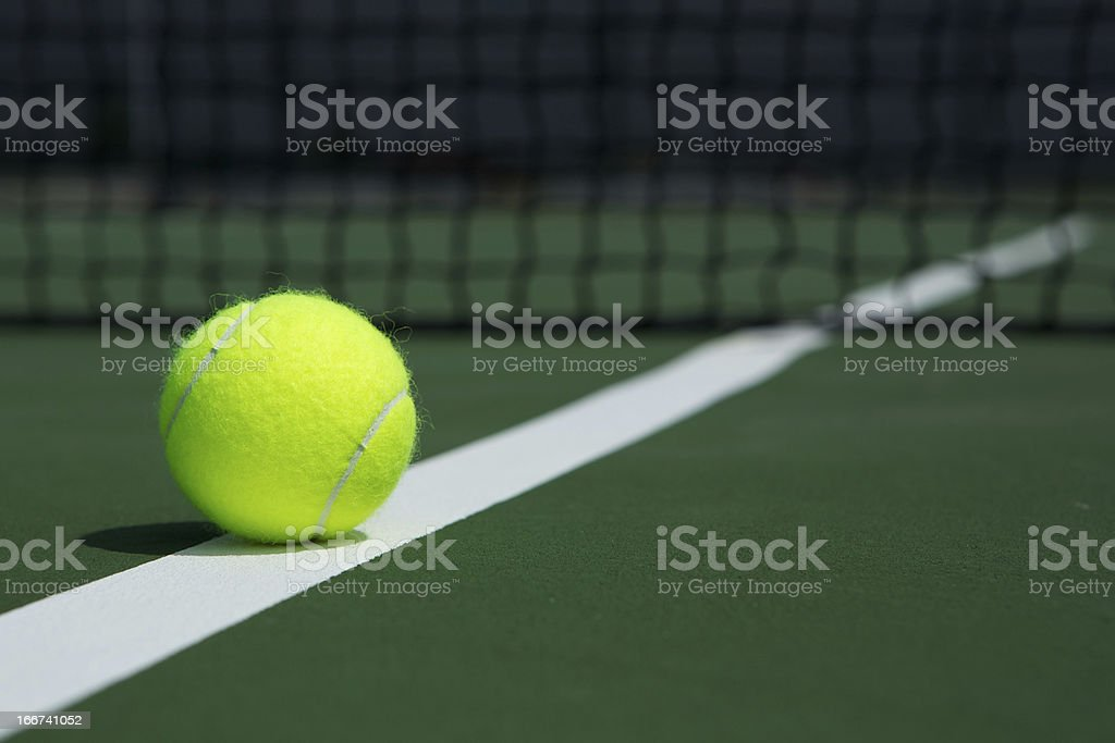 Tennis Ball with Net in the Background stock photo