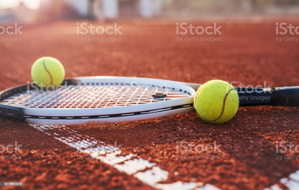 Tennis ball with racket on the tennis court. Sport, recreation concept stock photo
