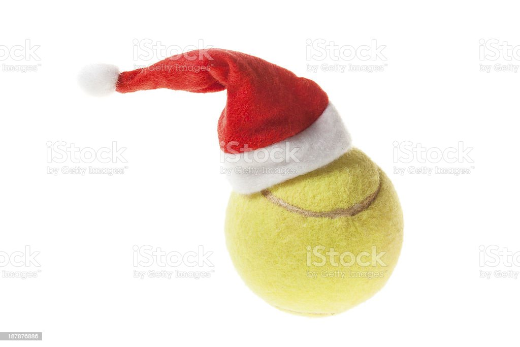 Tennis ball with santa hat royalty-free stock photo