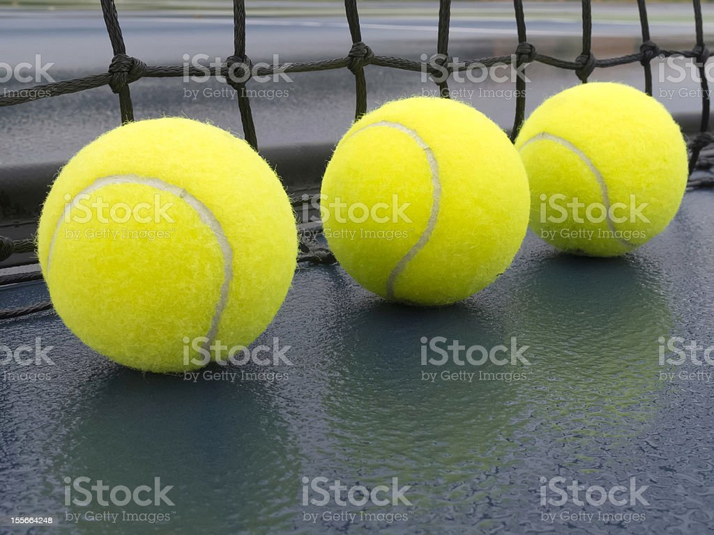 Tennis balls after rain royalty-free stock photo