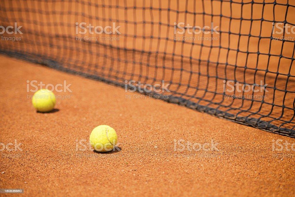 Tennis balls and net stock photo