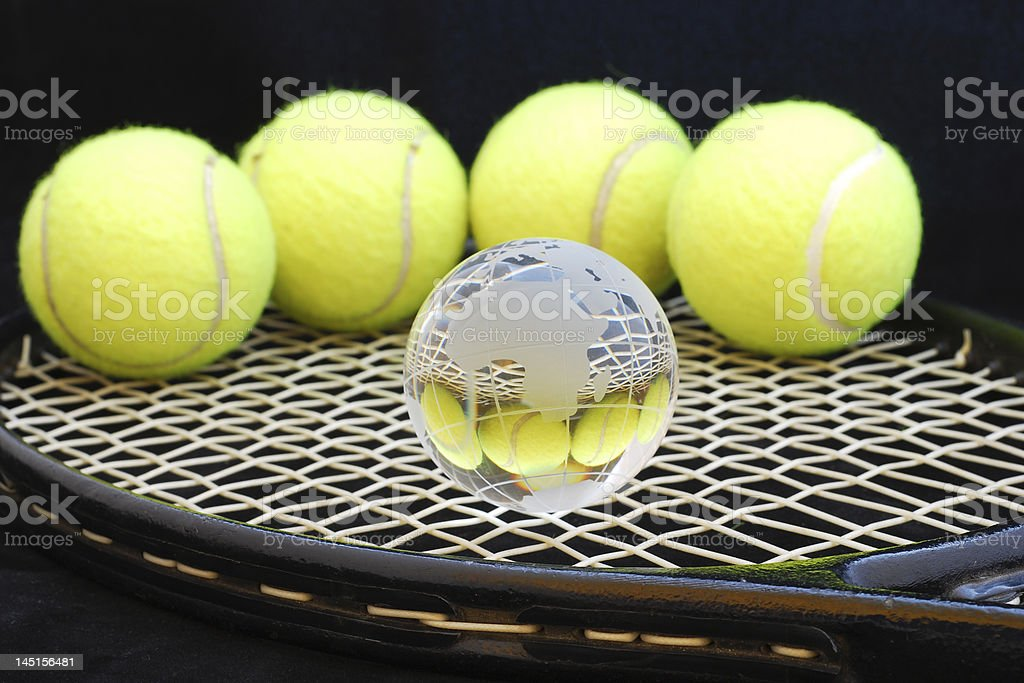 Tennis balls and one globe royalty-free stock photo