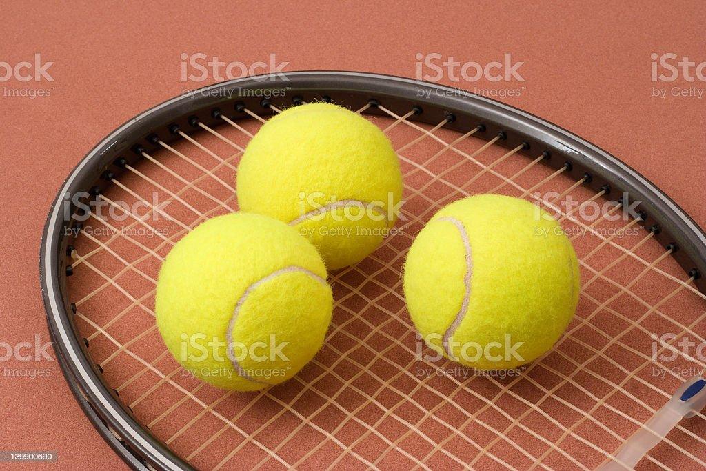 Tennis balls and racket royalty-free stock photo