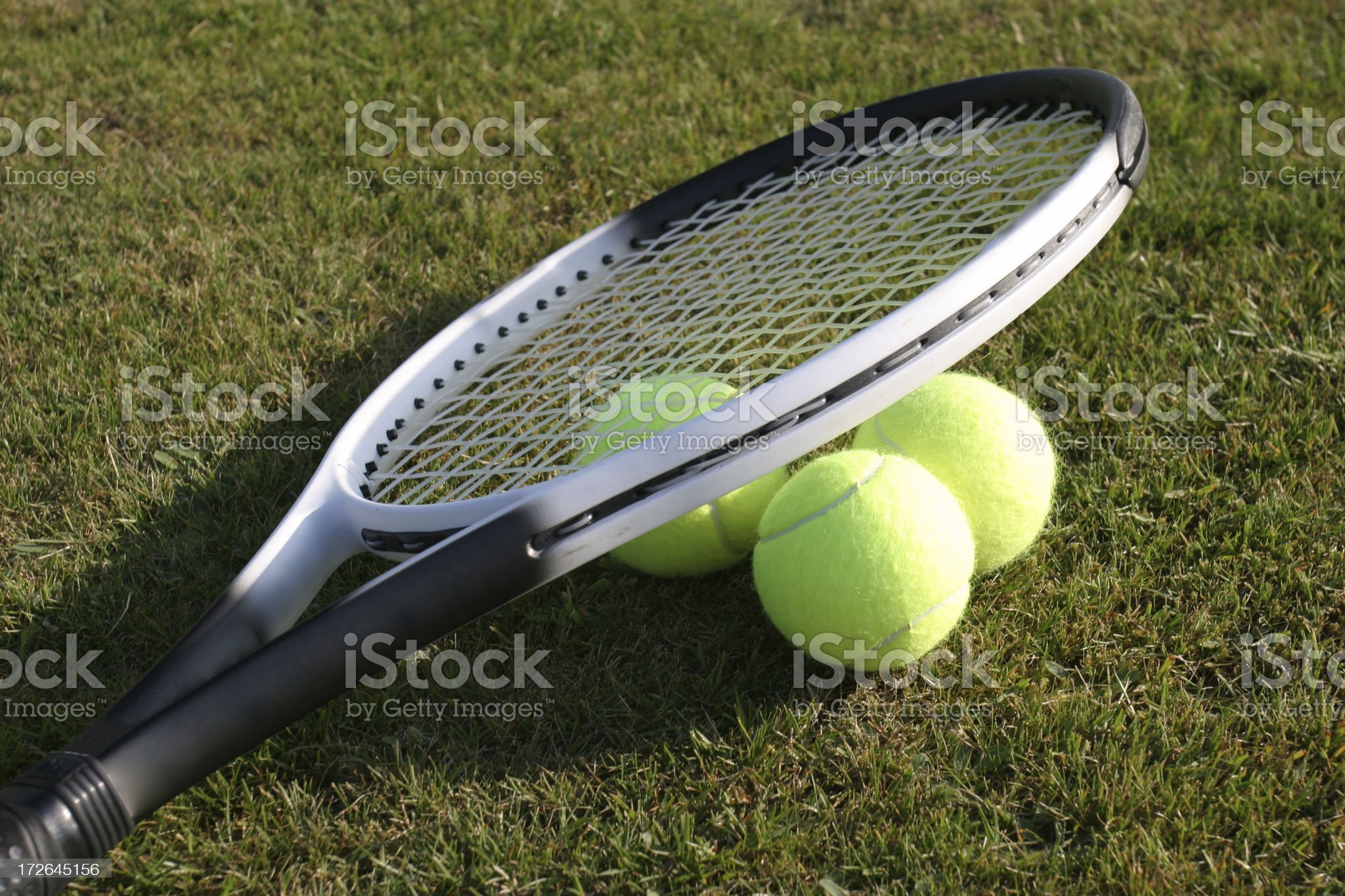 Tennis balls and racquet royalty-free stock photo