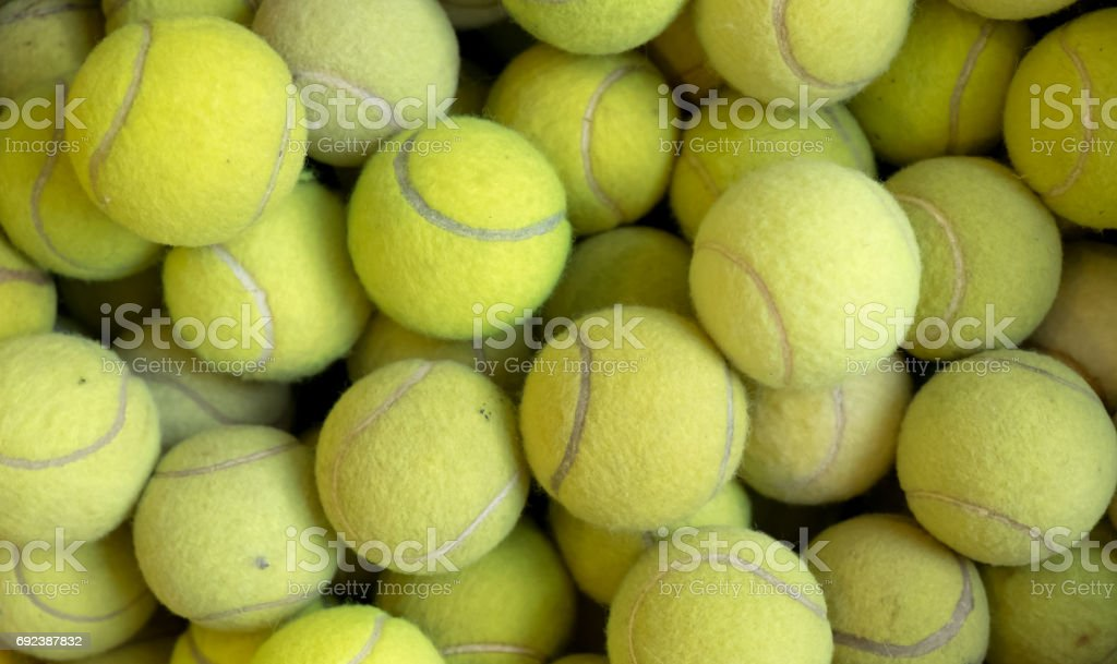 Tennis balls background texture, pile of tennis balls stock photo