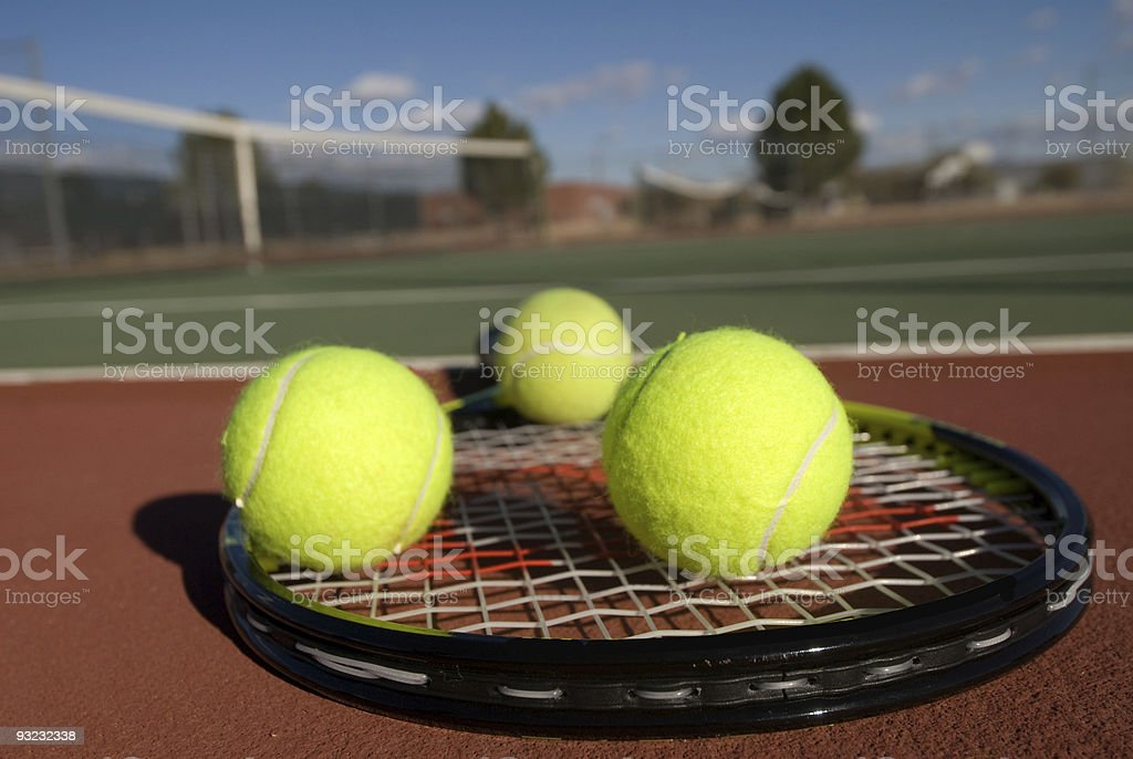 Tennis balls, court and racquet royalty-free stock photo