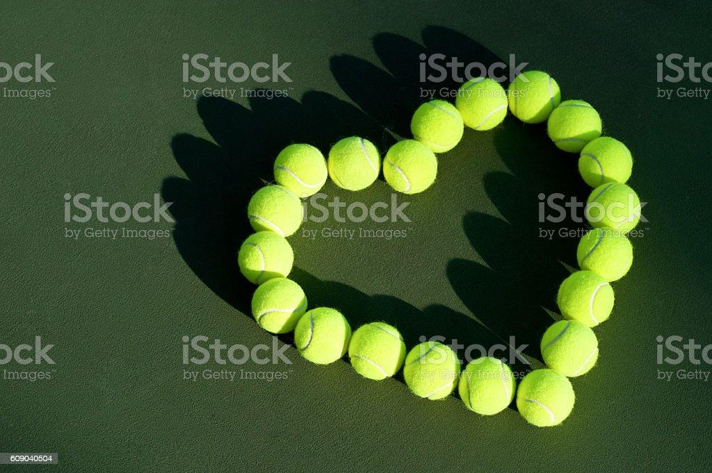 Tennis Balls in Heart Shape Love stock photo