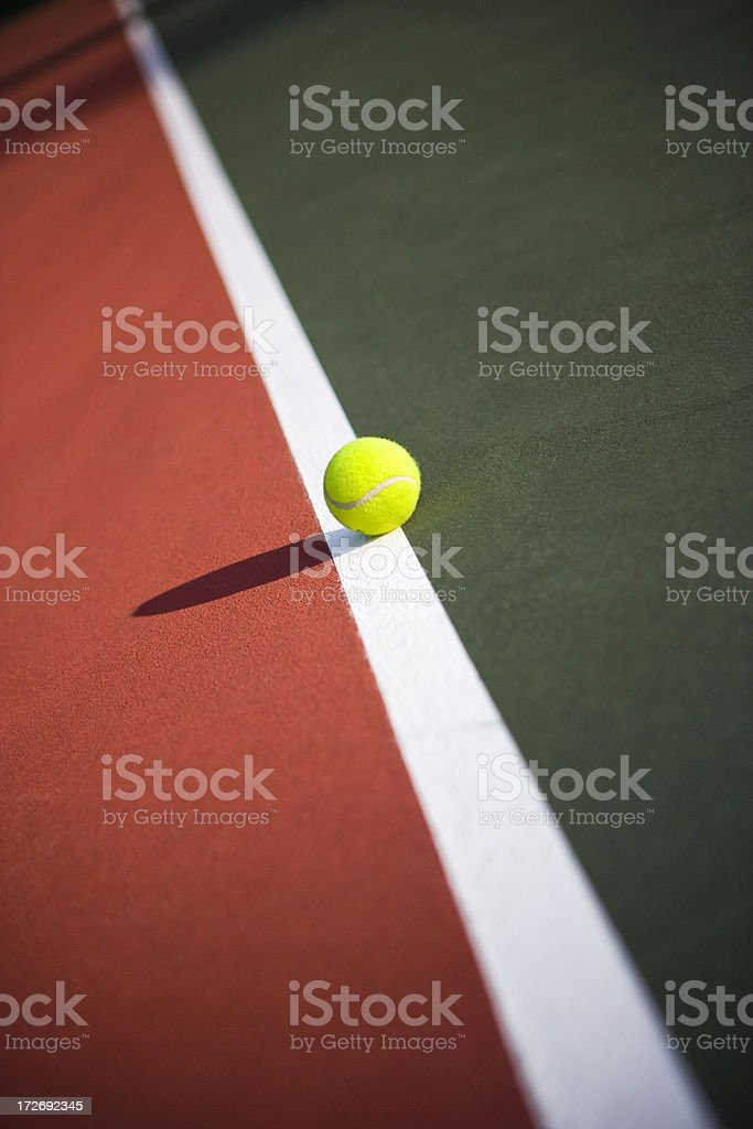 Tennis balls on a clay court royalty-free stock photo