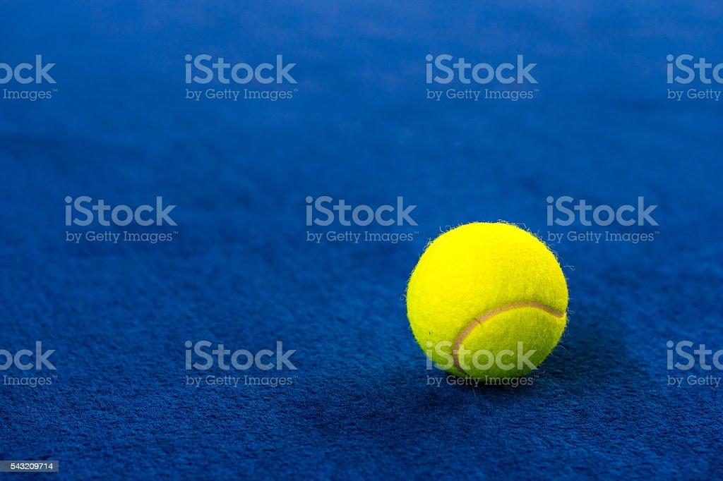 Tennis balls on blue court. stock photo