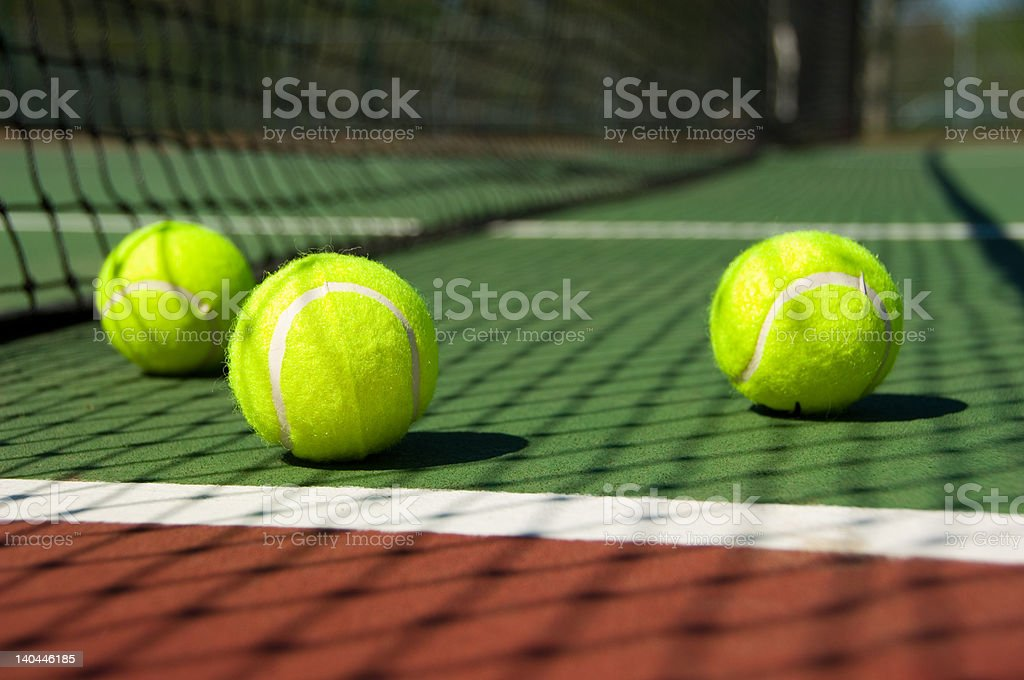 Tennis balls on Court royalty-free stock photo