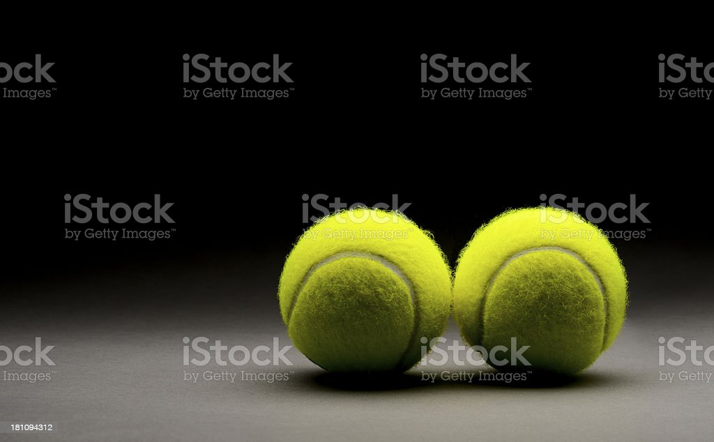 Tennis balls on grey background royalty-free stock photo