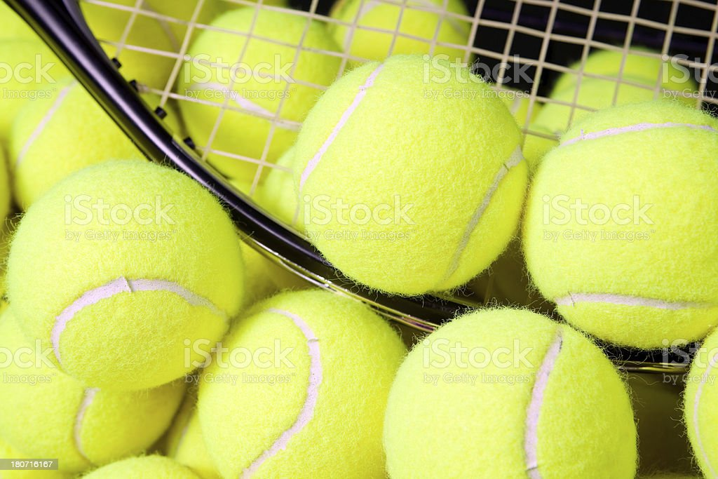 Tennis Balls on Racket with Group stock photo