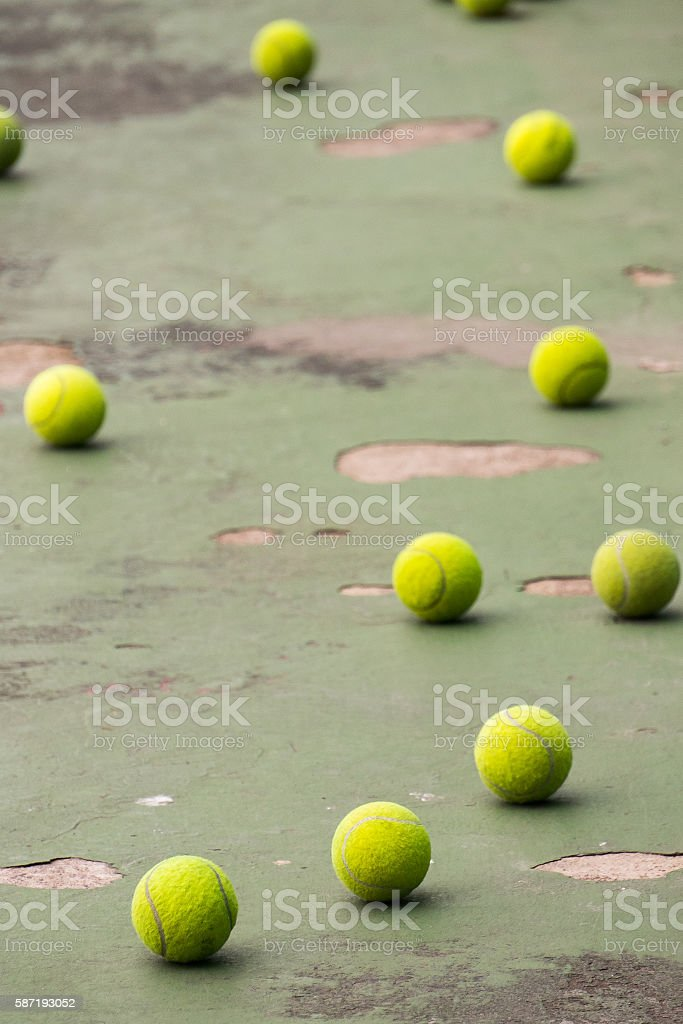 tennis balls spilled out on tennis court stock photo