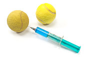 Tennis  balls with a syringe isolated on white