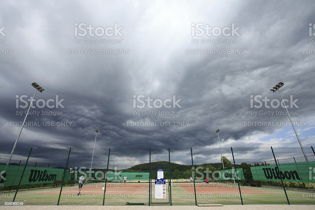 Tennis before the storm stock photo