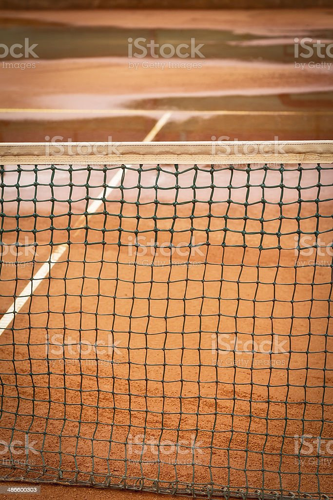Tennis clay court after rain royalty-free stock photo