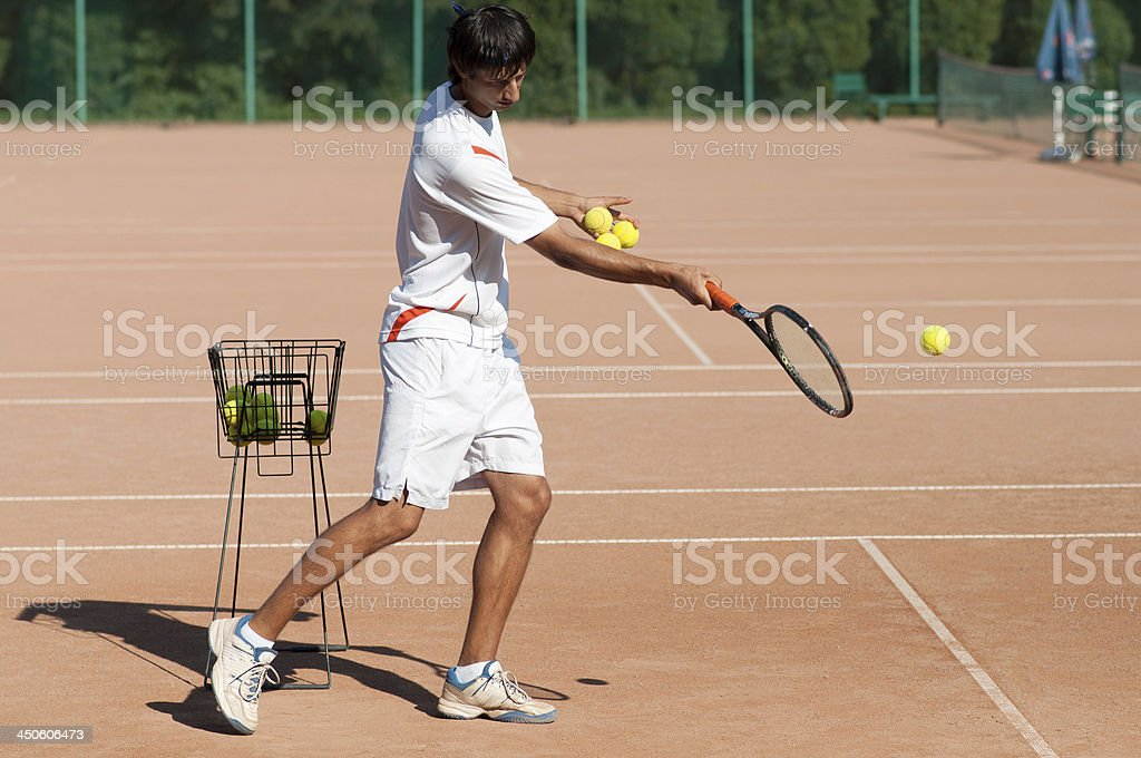 tennis coach showing forehand royalty-free stock photo