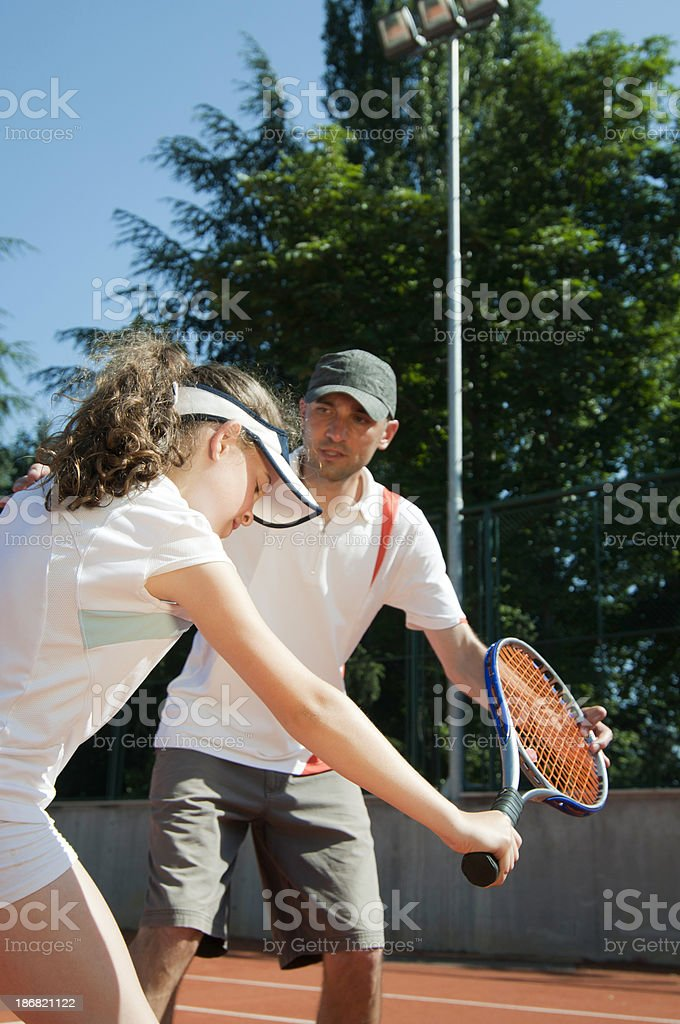 Tennis coach with young talent royalty-free stock photo
