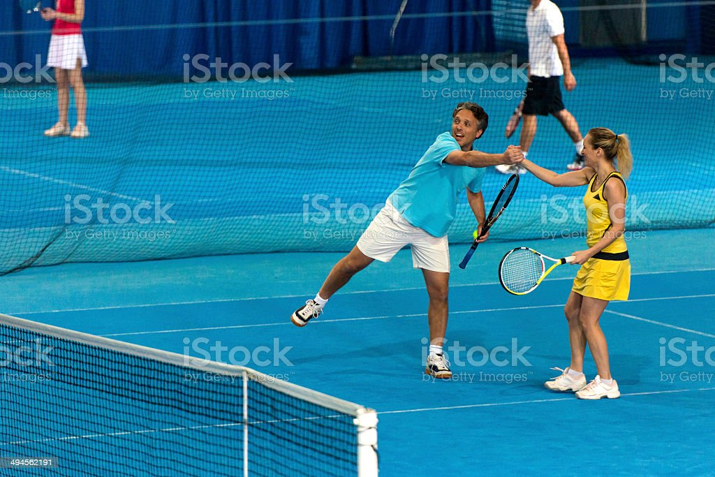 Tennis Co-players Giving A High Five royalty-free stock photo