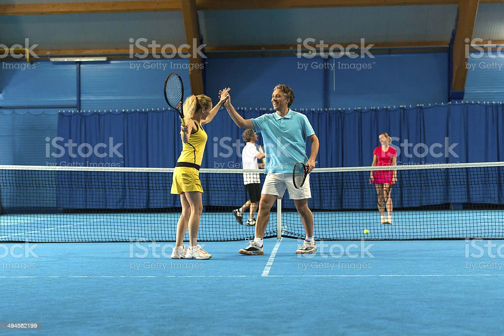 Tennis Co-players Giving A High Five stock photo