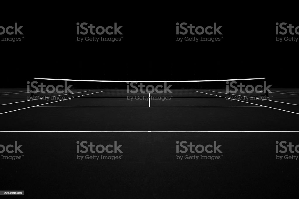 Tennis court at night stock photo
