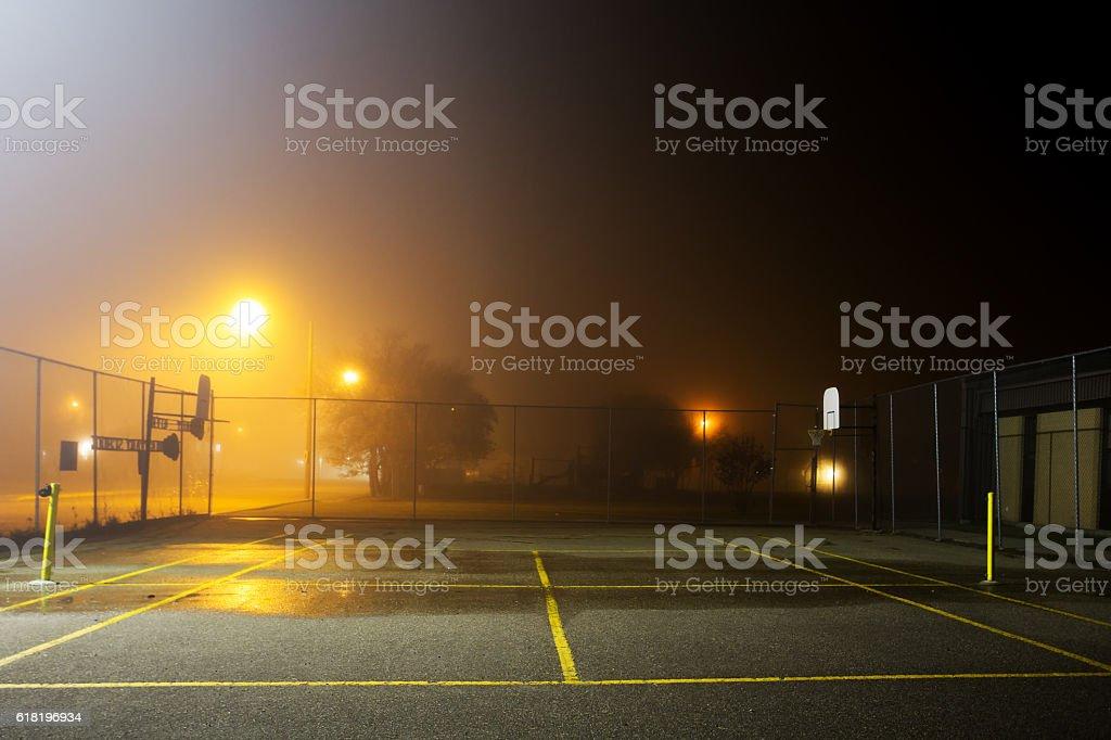 Tennis court at night stock photo