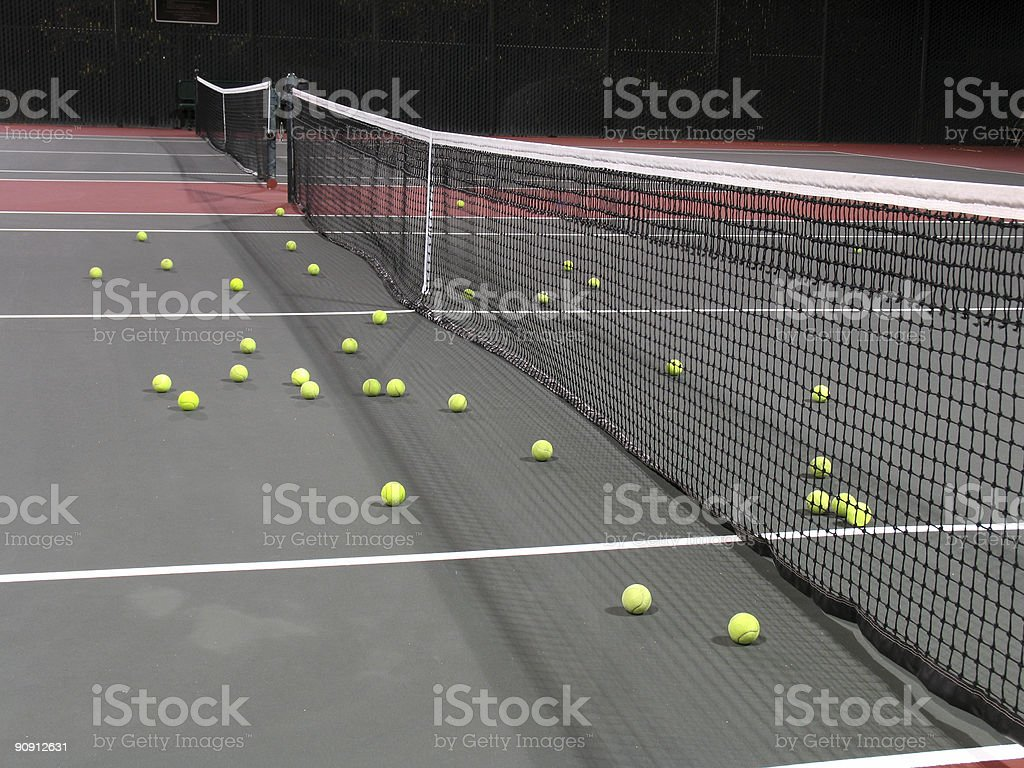 Tennis court at night with many balls scattered royalty-free stock photo