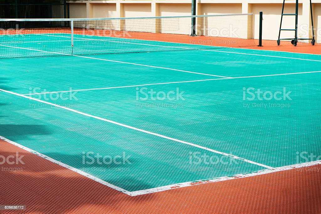 tennis court made with futsal material ground stock photo