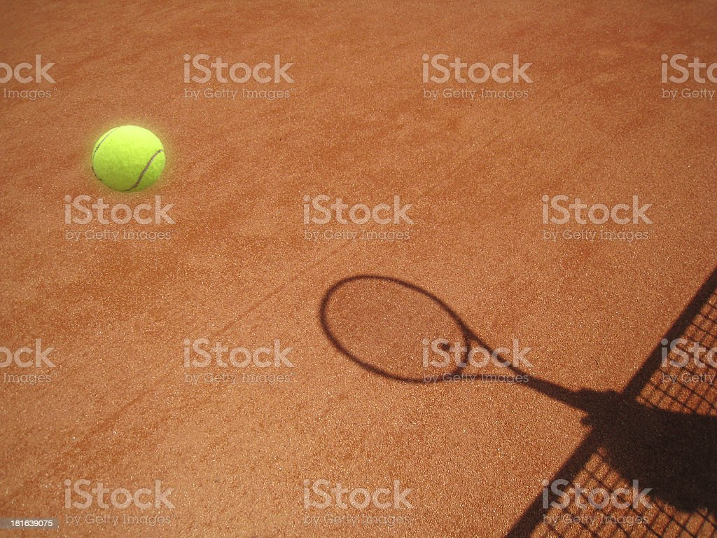 tennis court net and racket shadow with ball royalty-free stock photo