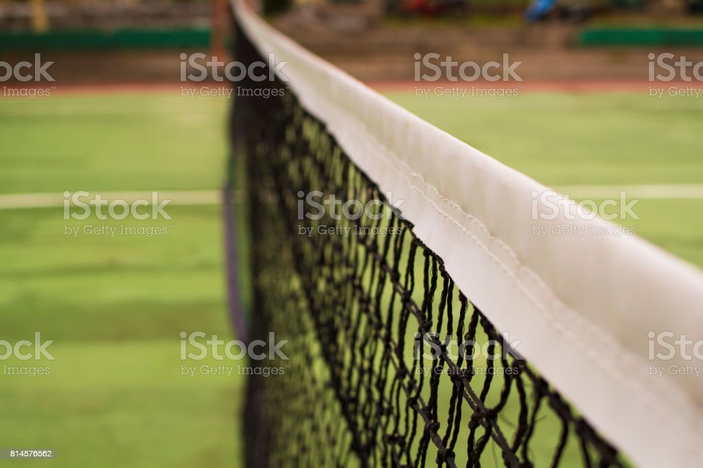 Tennis court net in warm sunlight. Tennis court divider. stock photo