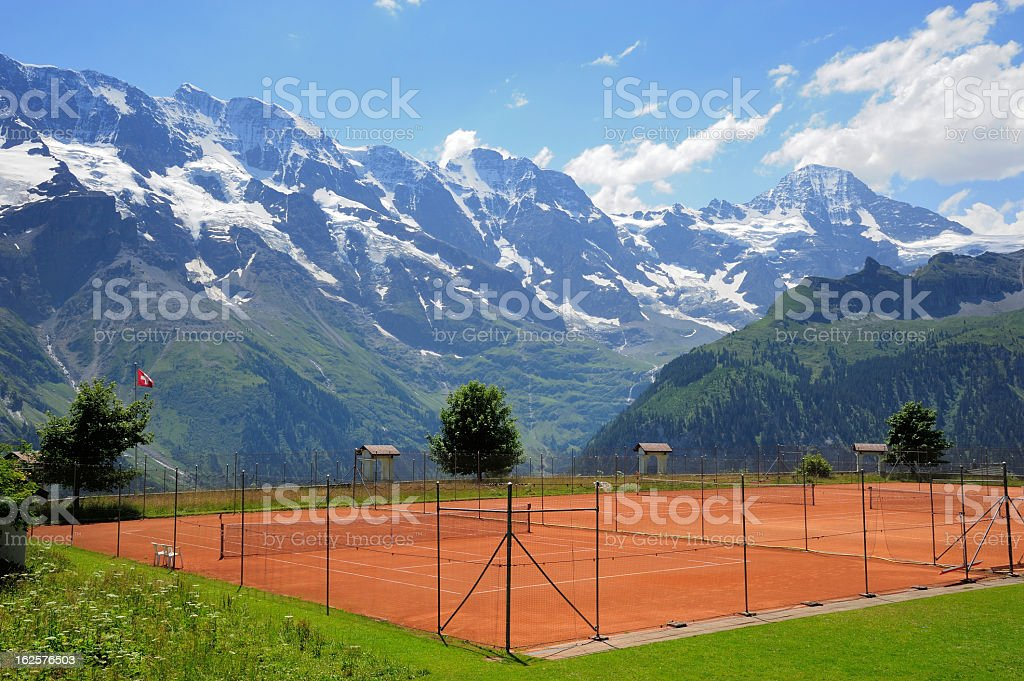 Tennis Court with Mountain Background stock photo