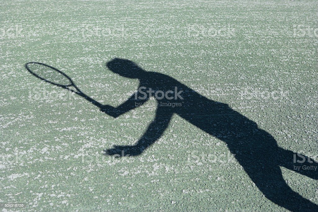Tennis forehand shadow silhouette on har-tru tennis court stock photo