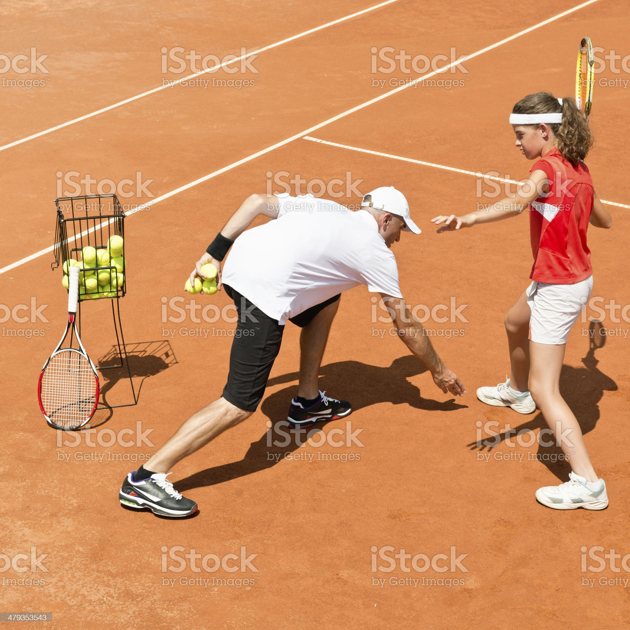 Tennis instructor working with girl royalty-free stock photo