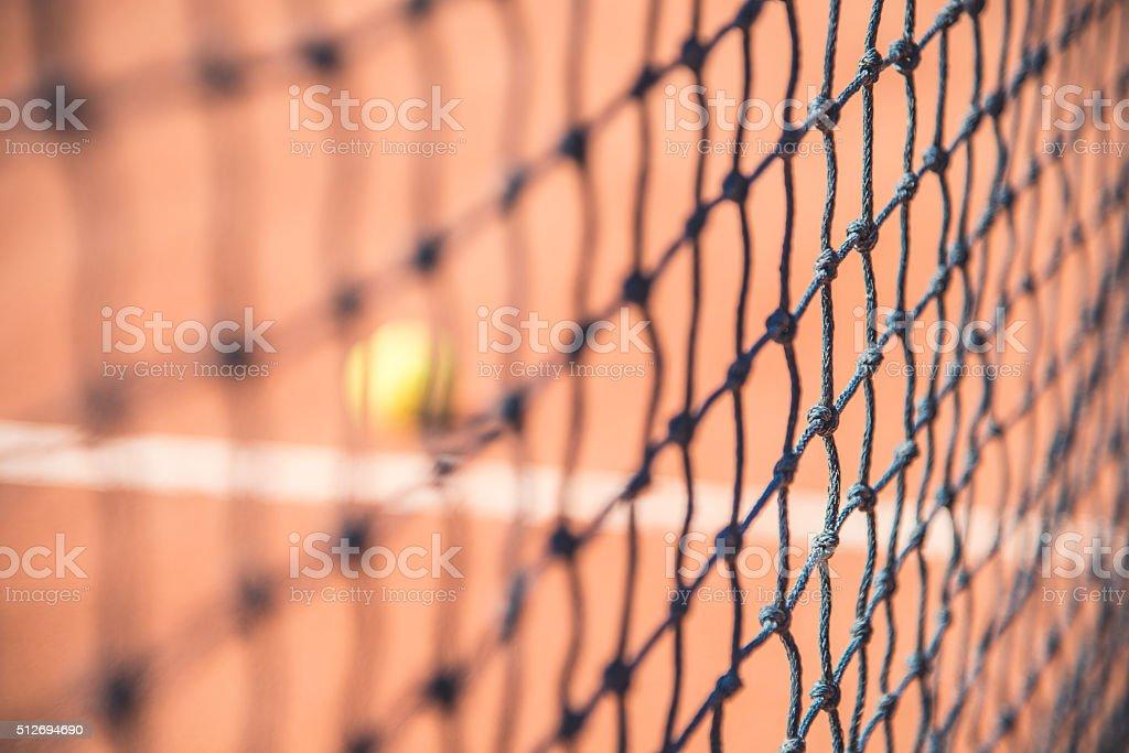 Tennis net and ball stock photo