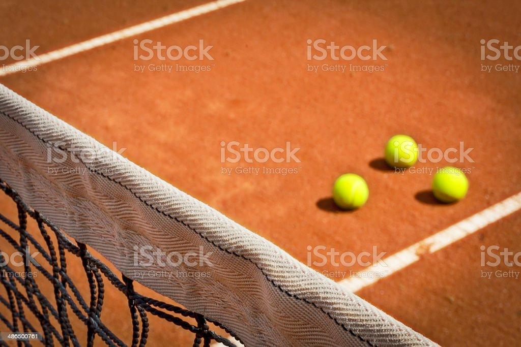 Tennis net and balls stock photo