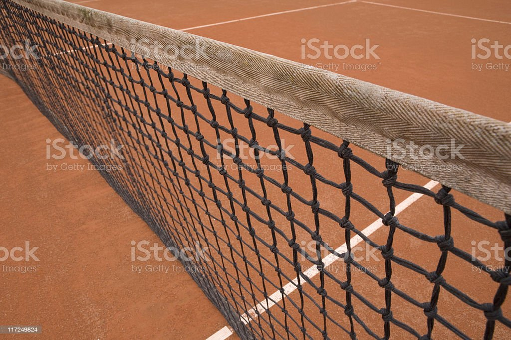 tennis net on a clay court stock photo